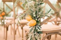 14 decorate your aisle chairs with olive branches and fresh citrus to give it an aroma and a proper feel