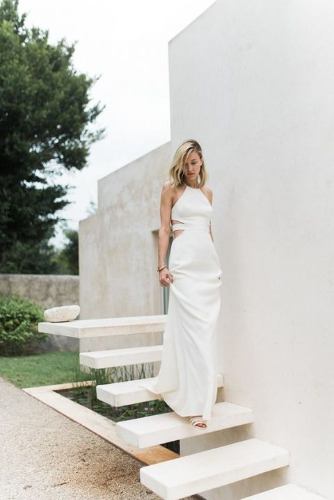 a plain halter neckline wedding gown with side cutouts is a chic idea to combine two different trends