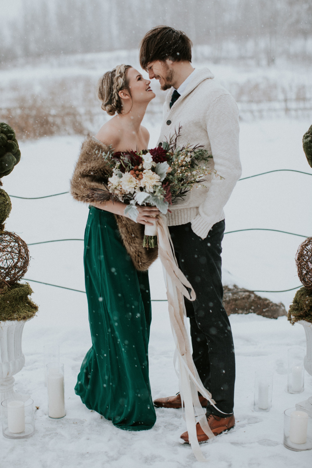 casual outfits   an emerald strapless wedding dress plus a faux fur stole and black pants with a creamy shirt and sweater over it