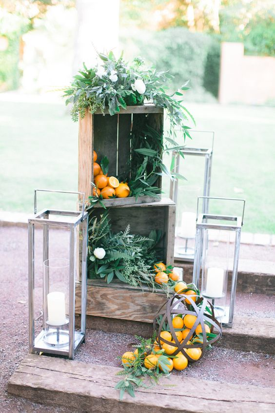 simple rustic Mediterranean decor with crates, candle lanterns, citrus and much greenery all over