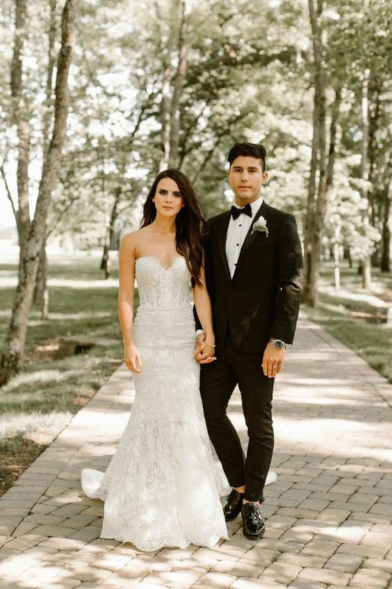a gorgeous lace mermaid wedding gown with a bustier top and a train for a sophisticated bride