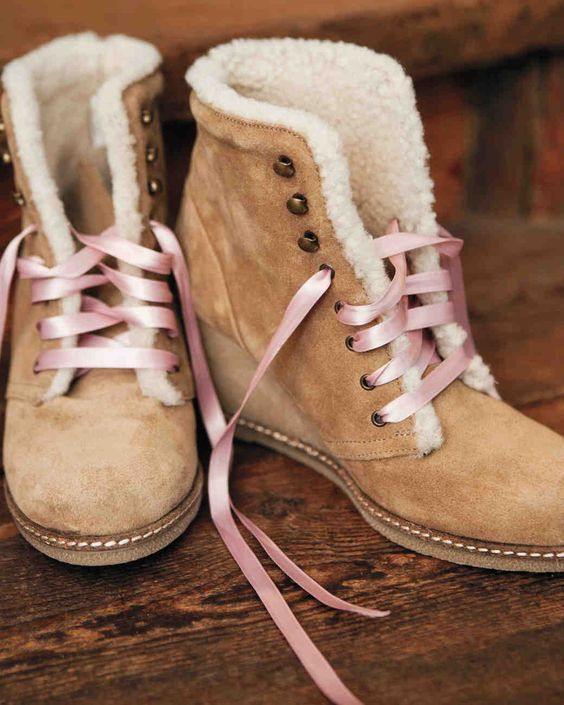 cozy and comfortable amber-colored fur boots with pink lacing up is a girlish and fun idea to try