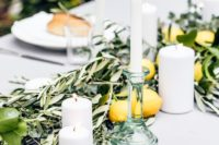 16 simple table styling with olive branches, lemons and limes plus white candles work well with a white tablecloth for a relaxed feel