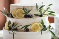 18 a buttercream wedding cake with citrus slices, blackberries and greenery is a cool idea for a Mediterranean wedding