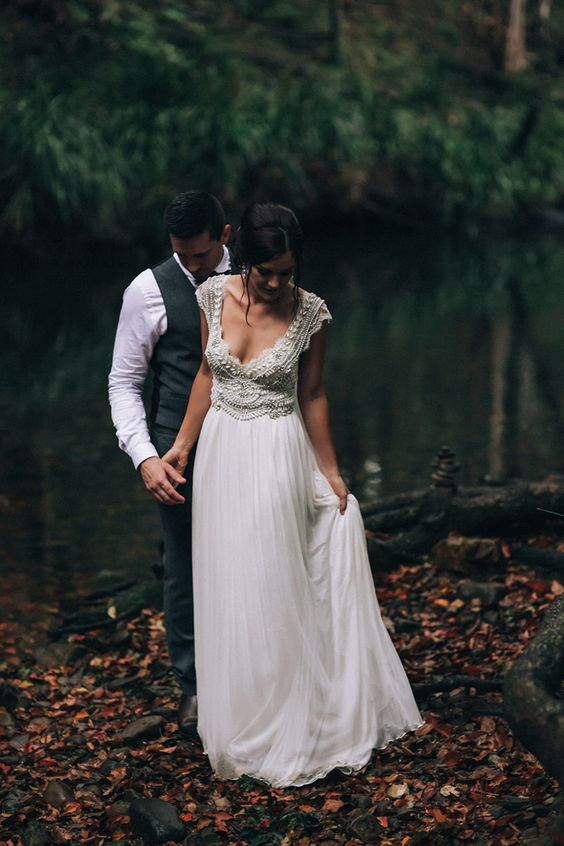 a chic vintage inspired wedding dress with an embellished bodice, a V neckline and a layered skirt