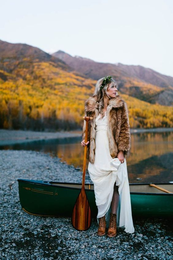 a fur coat and comfy brown boots make the bridal look complete and she feels comfortable outside