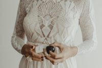 19 a chic boho-inspired geometric wedding gown with a fitting silhouette, long sleeves and a high neckline