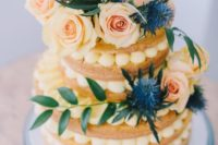19 a delicious naked wedding cake topped with fresh blooms, thistles and greenery looks very Mediterranean-like