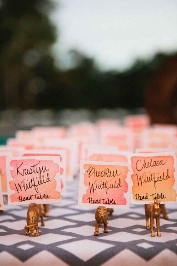 watercolor coral and pink wedding escort cards combine two trends in one