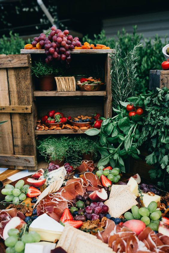 a gorgeous wedding food station wiht lots of fruits and berries, charcuterie, cheeses and crackers is ideal for a Mediterrnean wedding