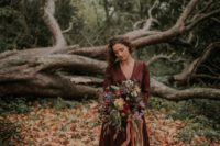 20 a silk chocolate brown wedding dress with a deep V-neckline and an A-line skirt for a fall hygge wedding