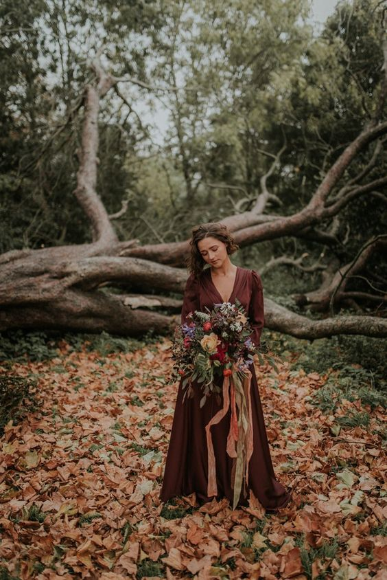 a silk chocolate brown wedding dress with a deep V-neckline and an A-line skirt for a fall hygge wedding