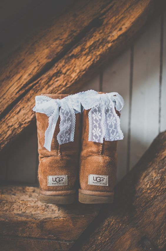 ugg boots decorated with little lace bows on the back to show these are bridal boots