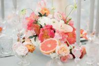 21 a beautiful wedding tablescape in dove grey and with orange, coral and hot pink details that make it bolder