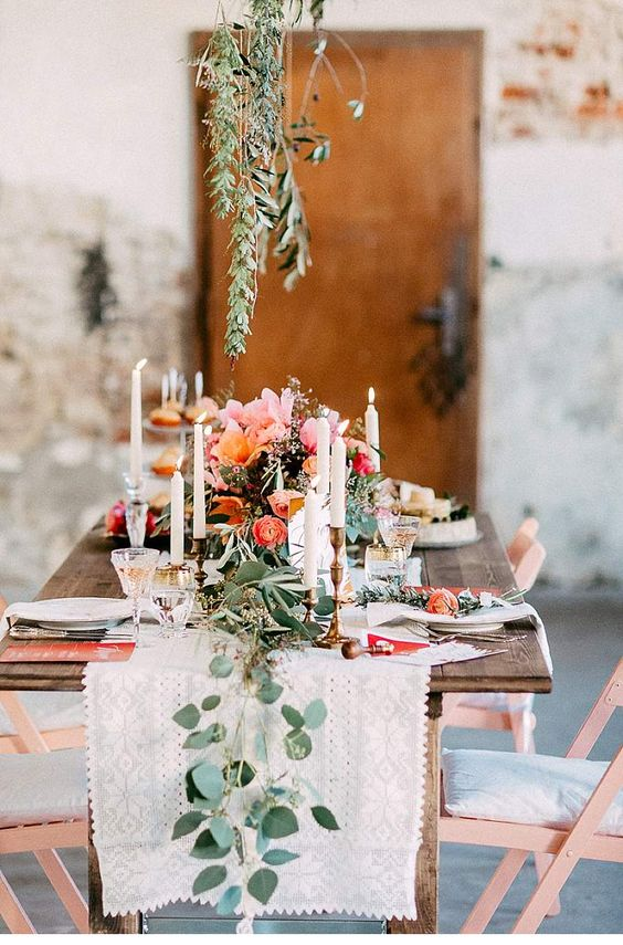 copper chairs and peachy and coral blooms on the table is a cool idea, and lush greenery refreshes the look