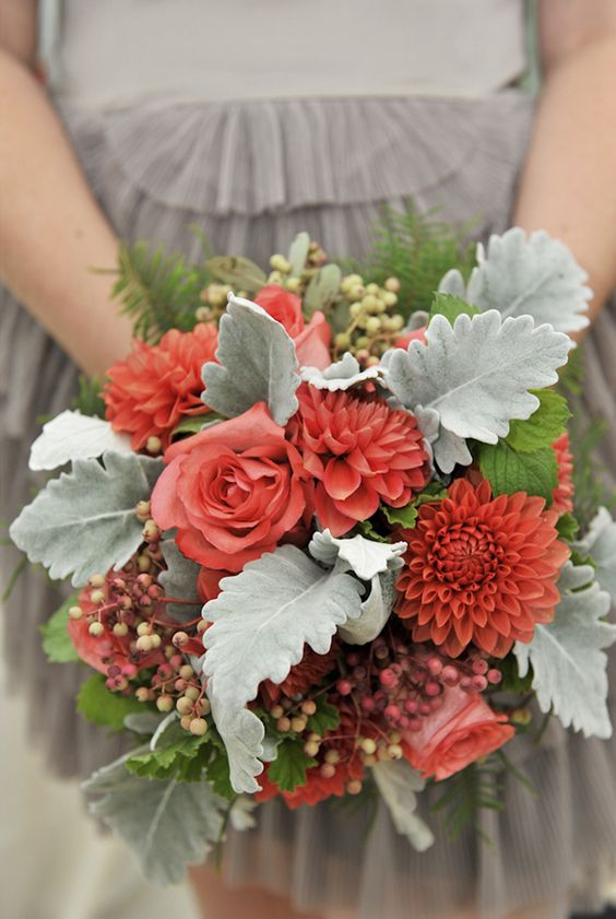 a bold bridesmaid bouquet with berries, pale greenery and coral blooms is a great idea to rock