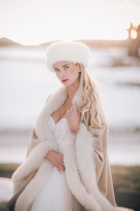 a chic white fur hat is a gorgeous idea, match it with a fur capelet for maximal comfort