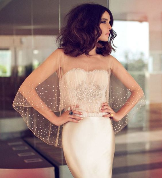 a sheer champagne-colored wedding cape with beading looks very refined and sparkling
