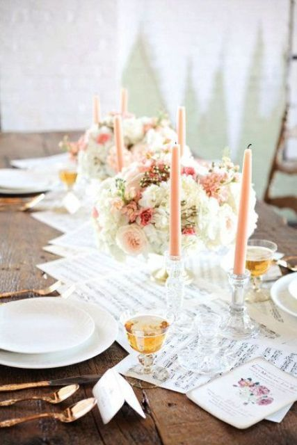 a sweet vintage-inspired wedding tablescape with note paper, peachy candles and blooms, copper cutlery and white plates