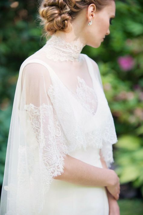 a Chantilly lace turtleneck cape over a deep V neckline minimalist wedding dress adds romance to the look
