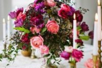23 a lush wedding centerpiece in coral, purple, hot pink, textural greenery and berries is great for a decadent wedding