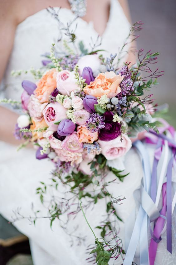 a beautiful wedding bouquet in blush, lilac, purple and coral plus herbs and greenery is a tender idea