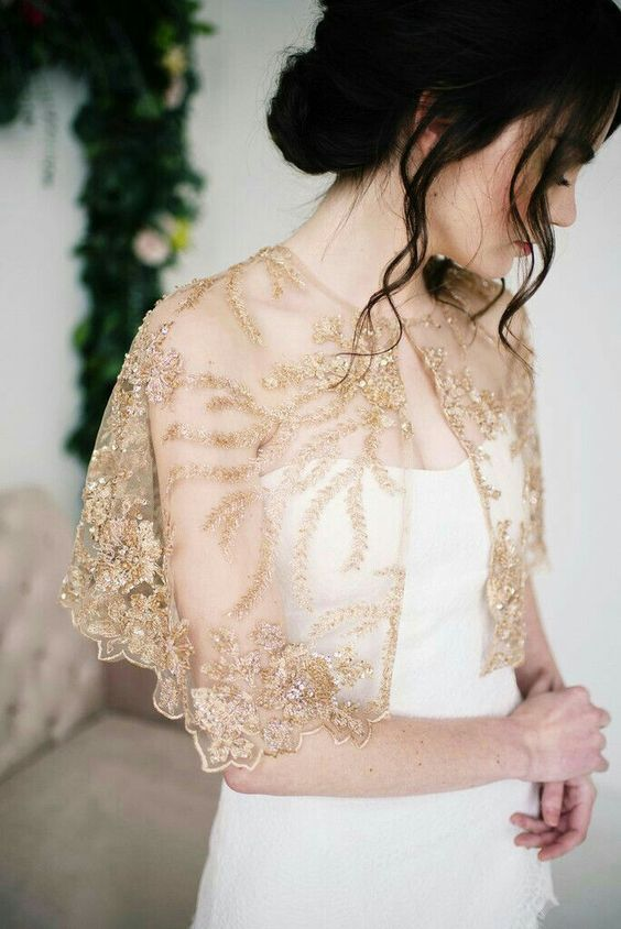 an embellished and embroidered wedding capelet in gold will add color to your space