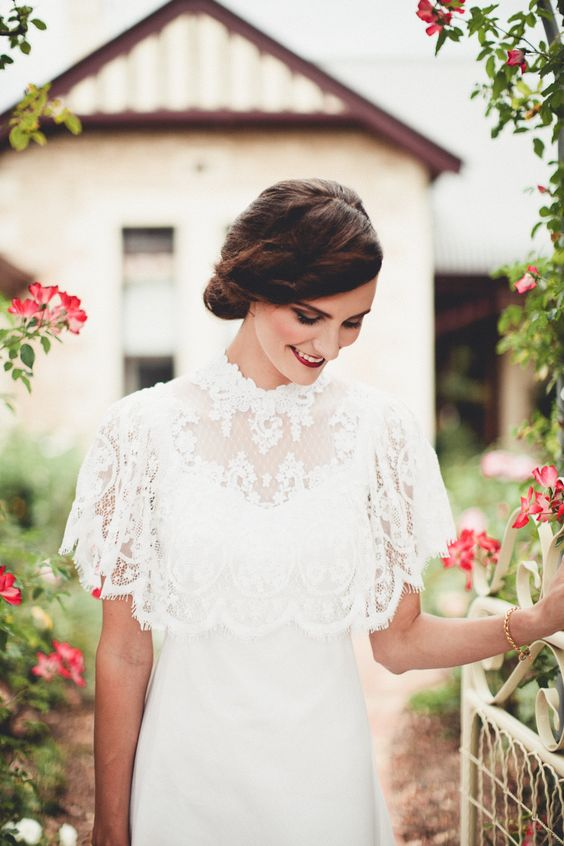 a lace capelet over a plain wedding dress will add romance to your wedding outfit