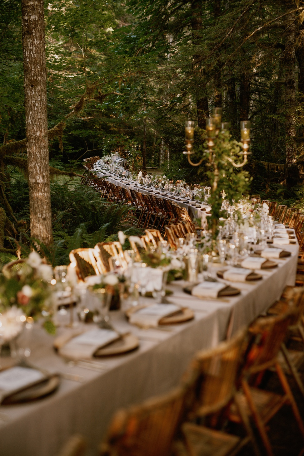 This wedding should be seen at least because of the longest reception table in the woods