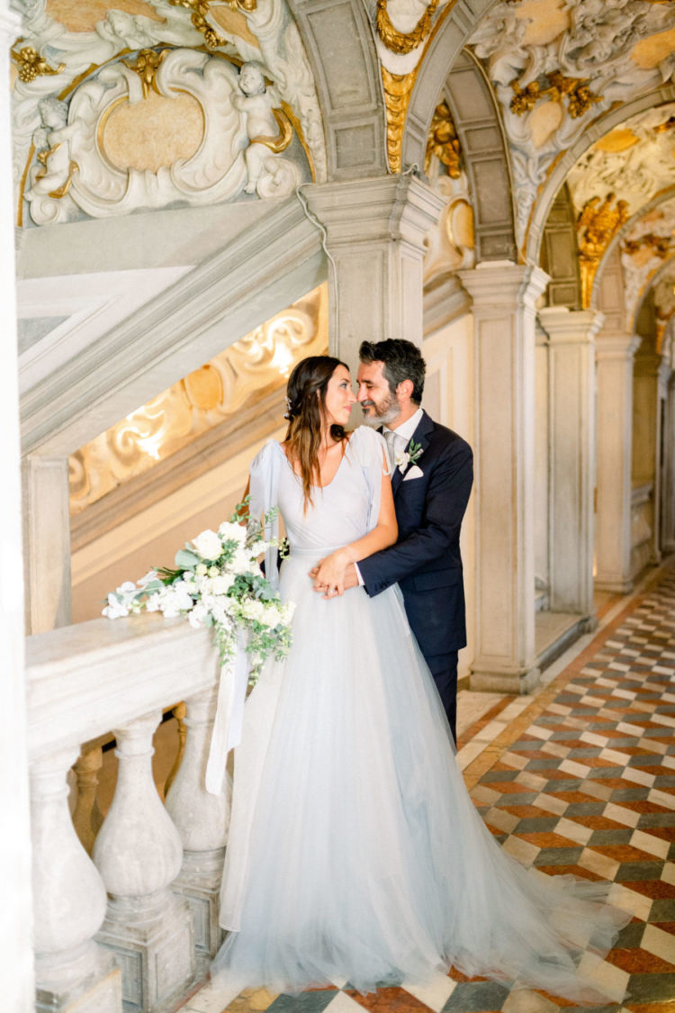 The bride was wearing a custom-made light blue wedding dress with dove grey tones and a small train