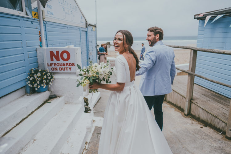The bride was wearign a plain A-line wedding gown with long sleeves and a cutout back