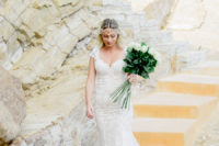 02 The bride was wearing a boho rinestone headpiece and a lace fitting wedding gown with a train