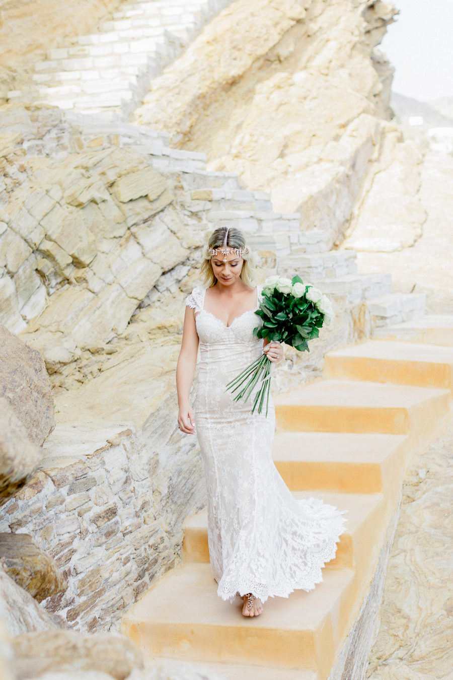 The bride was wearing a boho rinestone headpiece and a lace fitting wedding gown with a train