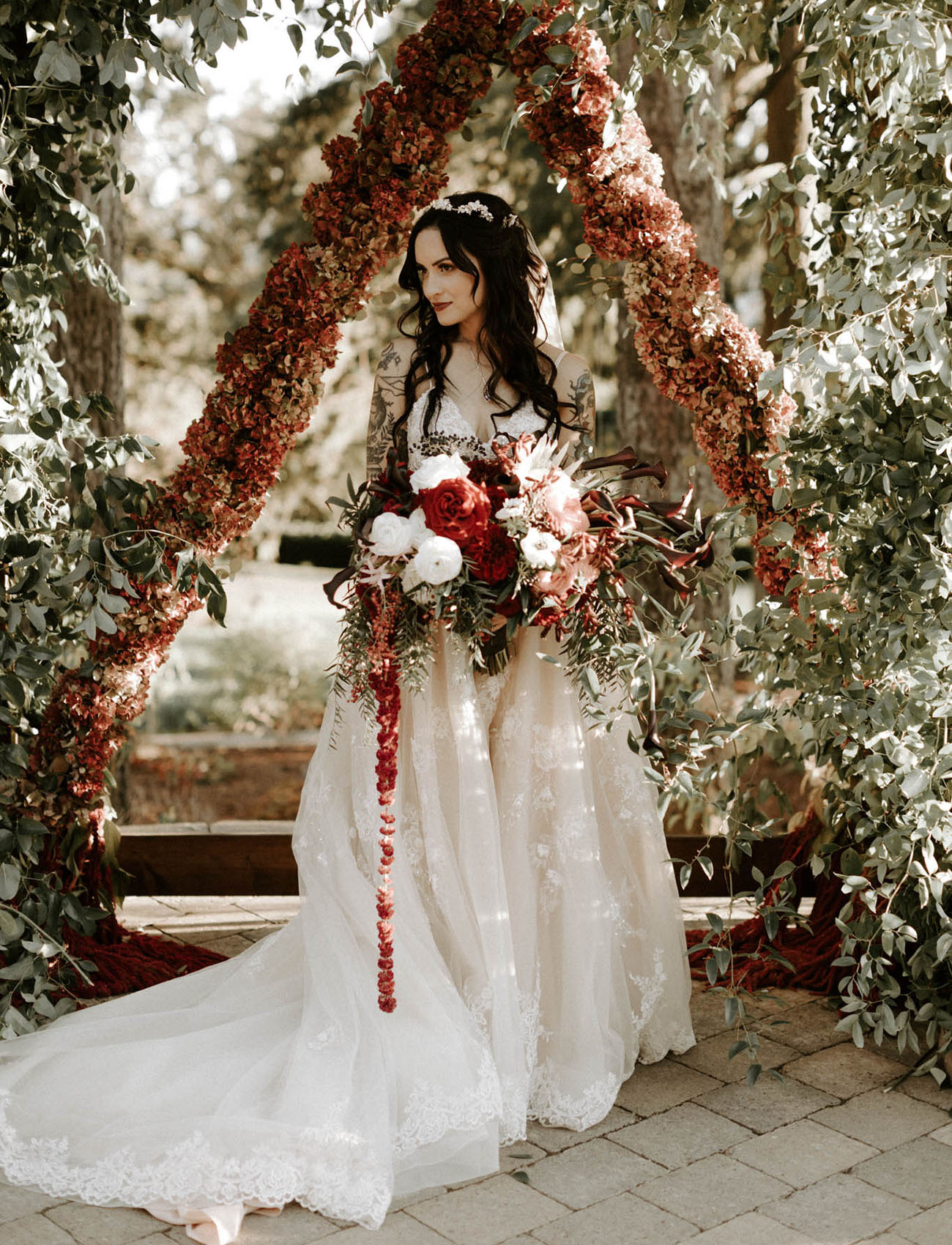 bride in a gorgeous lace wedding dress with a train