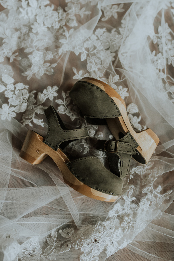 The bride was wearing comfortable olive green platform shoes