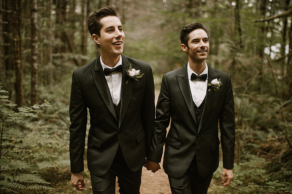 The couple was wearing the same black three piece suits with bow ties