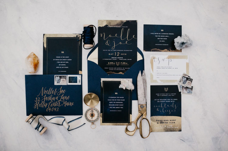 The wedding invitation suite was done in black and gold leaf, with elegant calligraphy