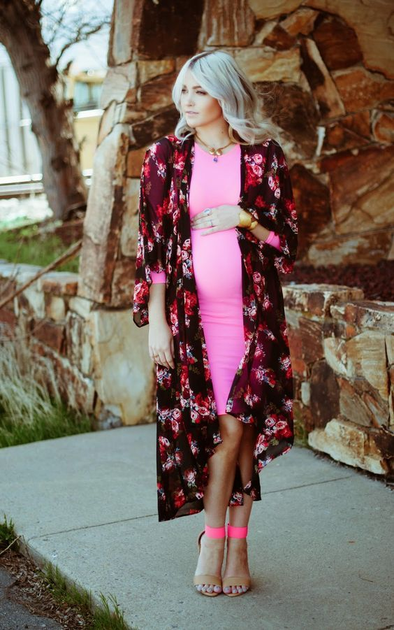 a neon pink over the knee dress with long sleeves, a dark floral kimono, hot pink and nude shoes for a spring wedding