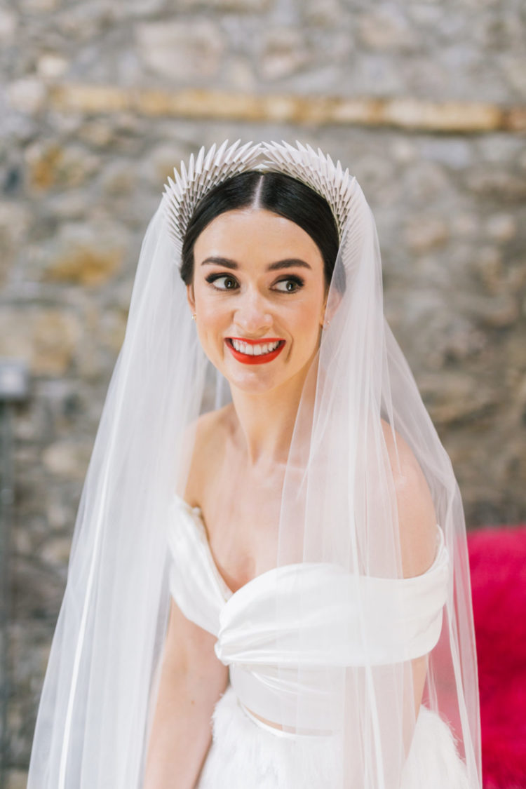 She had a killing headband with a veil and was rocking a red lip