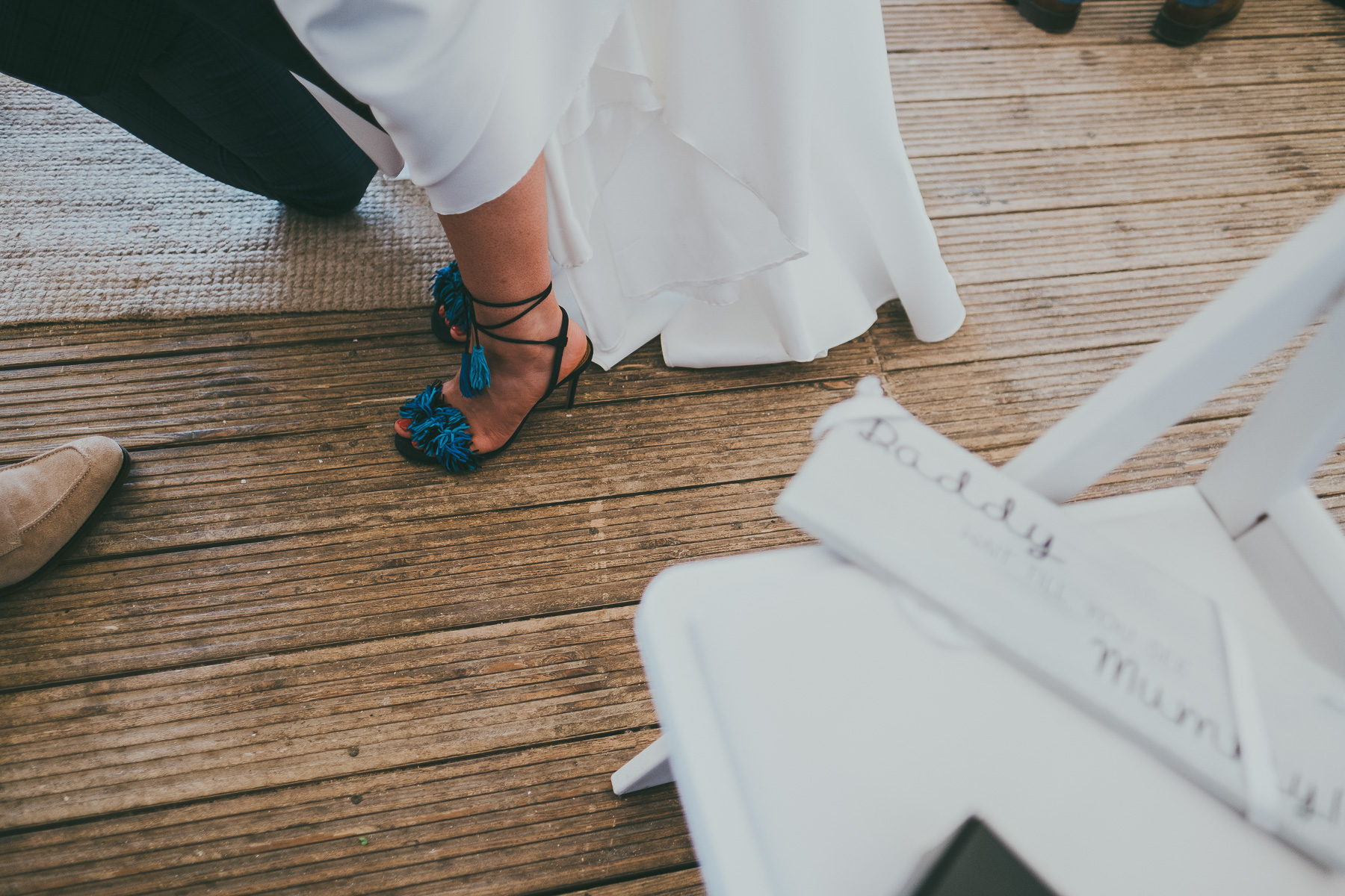 She was rocking cool blue pompom and tassel shoes with lacing up