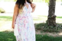 03 a beautiful bright floral print maxi dress with a V-neckline, no sleeves, a white clutch and pink shoes for a summer wedding