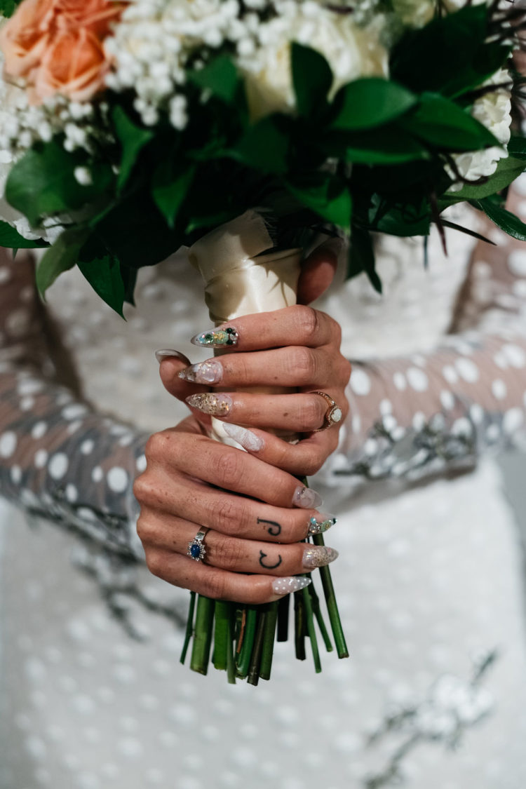 Look at this unique and all-mismatching bridal manicure, it's gorgeous