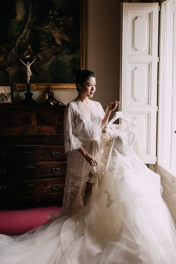 The bride changed for a fantastic classic ballgown with a lace bodice and a skirt with a long train