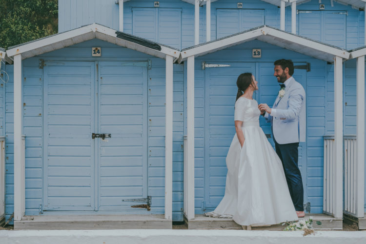 The groom was wearing a light blue shirt, a light blue blazer, navy pants and a bow tie