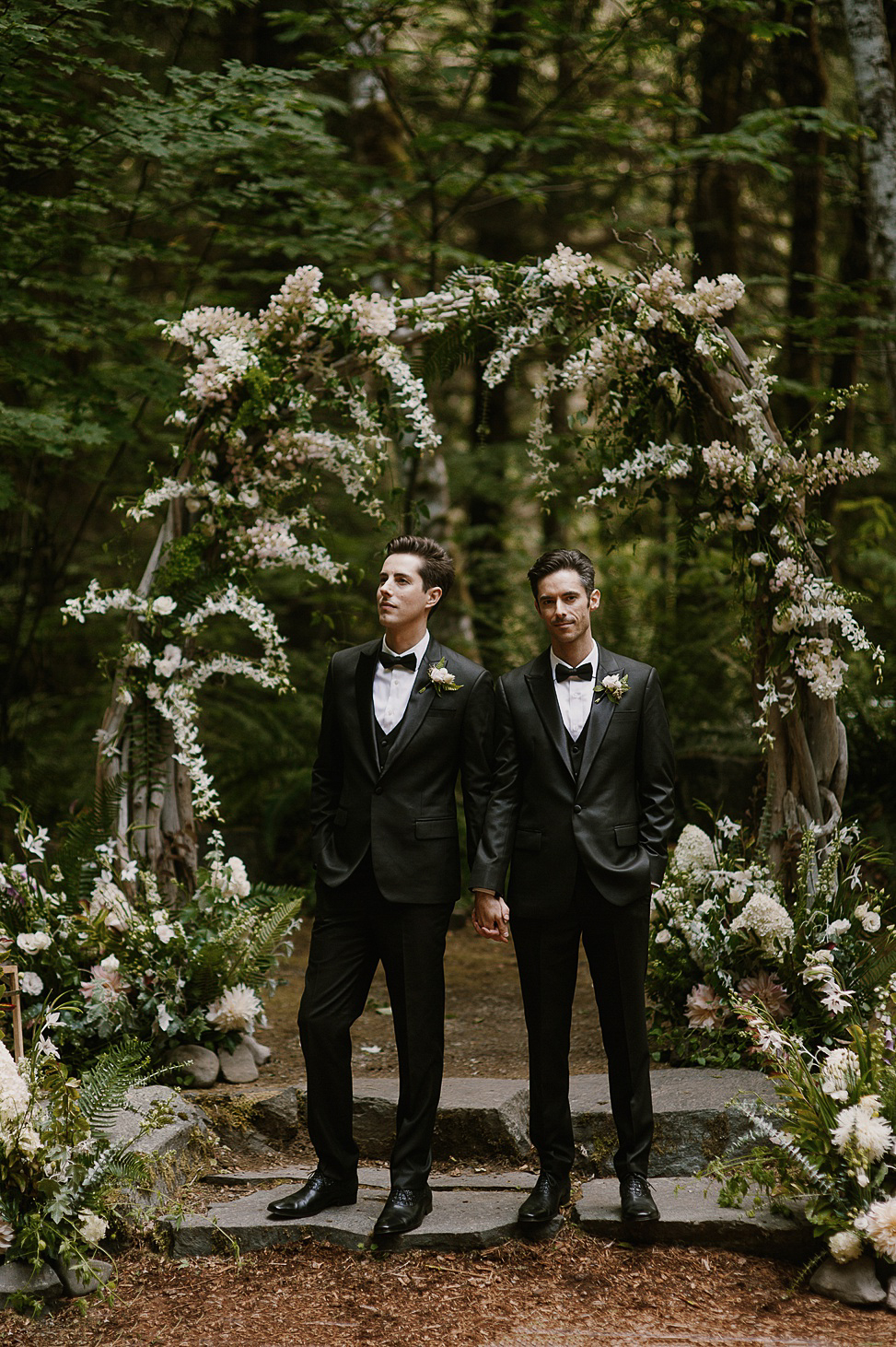 The wedding arch was made of driftwood and decorated with lush white blooms and greenery