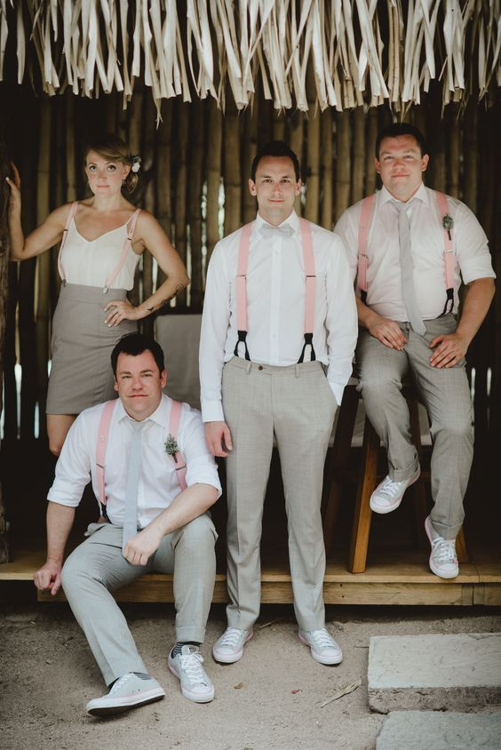 a chic groom's party wearing dove grey pants or a skirt, white shirts or a top, pink suspenders for a summer wedding