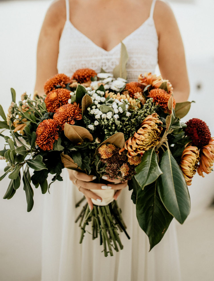 The bridal bouquet was done with lots of burgundy and rust blooms and lush greenery