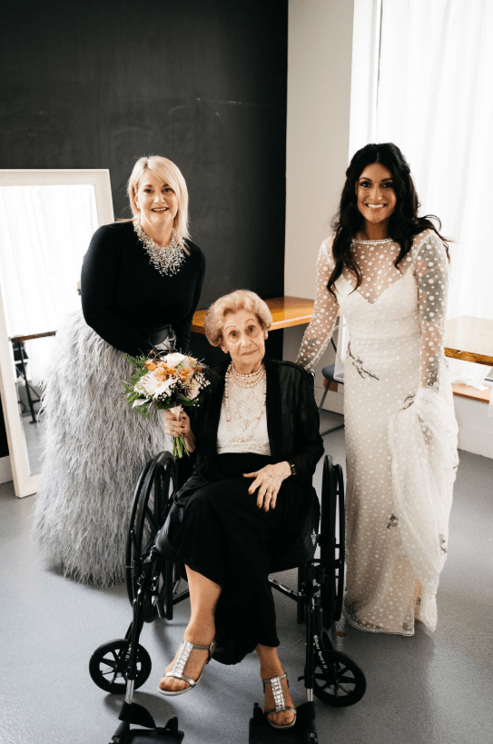 The bride's mom was wearing a super stylish look of a grey feather skirt and a black top with a statement necklace, and her granny prefered a black suit and embellished shoes