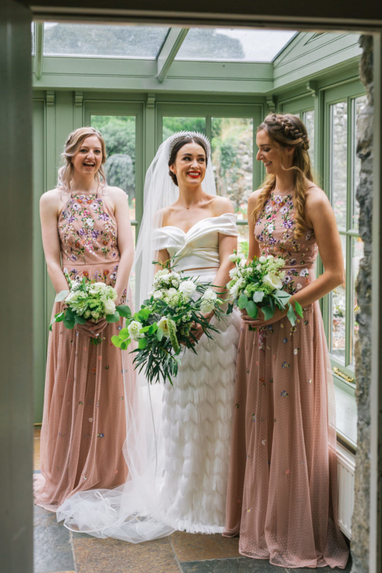 The bridesmaids were rocking blush maxi dresses with floral embroidery