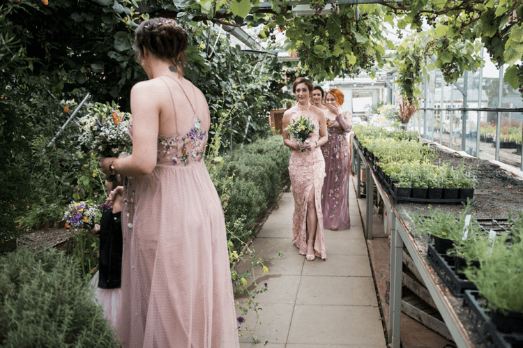 The bridesmaids were rocking mismatching pink floral gowns
